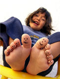 Painted toes. Of little girl royalty free stock image
