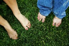Painted toes on grass stock images