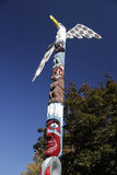 Painted totem pole in riverfront park Royalty Free Stock Photography