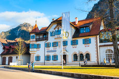 Painted traditional bavarian house near Neuschwanstein and german alps in Bavaria Stock Photo