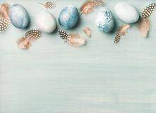 Painted traditional eggs for Easter holiday over light blue background Stock Photo