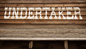 Painted undertaker sign. On layered wood boards Stock Photos