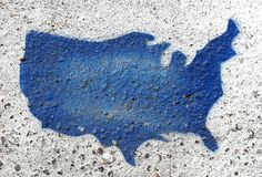 Painted USA Shape Detail from Curb. Stenciled map of USA on rough cement Royalty Free Stock Image