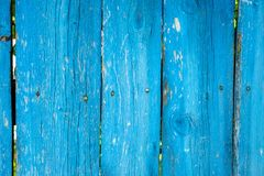Painted vibrant blue old wooden planking background with flaws. On it surface stock photography