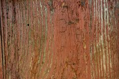 Painted vibrant brown old faded wooden planking background with flaws. On it surface stock images
