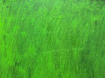 Painted vibrant green canvas background with brush strokes Stock Photography