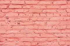 Painted vintage grunge brick wall texture, coral color, trendy urban background. Horizontal texture. For banner design royalty free stock image