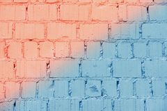 Painted vintage grunge brick wall texture, diagonal coral and blue colors, trendy urban background. For banner design royalty free stock photo