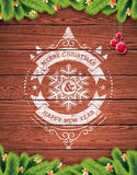 Painted vintage Merry Christmas and Happy New Year typographic design with redglass ball on wood texture background. Painted vintage Merry Christmas and Happy royalty free illustration
