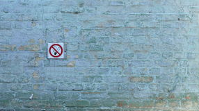 Painted wall. Painted with blue paint wall with a sign prohibiting smoking Royalty Free Stock Image
