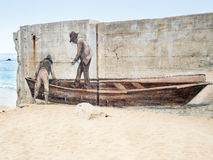 Painted wall, boat and fishermen Royalty Free Stock Images