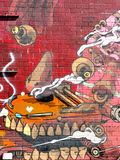 Painted wall on Brooklyn street. A brick wall in on a street in Brooklyn, New York is painted with images, designs and graffiti Stock Images