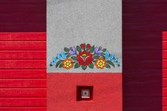 Painted wall of fire brigade building decorated with a hand painted colorful floral motives, folk art, Zalipie, Poland. ZALIPIE, POLAND - AUGUST 2, 2018: Painted royalty free stock photography