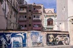 Painted wall in Havana. Havana, Cuba on December 23, 2015: Painted wall with old residential buildings in Havana stock image