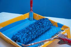 Painted wall and painting supplies. Painted wall and painting supplies ,roller, brush, tray liner and paint Royalty Free Stock Images