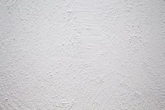 Painted wall with rough texture closeup photo. White plaster with brushed texture. White house wall. Greek architecture background. Pottery house wall. White Stock Photography