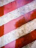 Painted wall with white and red stripes royalty free stock images