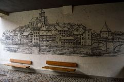 Bern, Switzerland - December 28, 2017: a painted wall withing the remains of an old tower. A painted wall withing the remains of an old tower, depicting the city royalty free stock photos