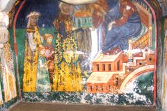 Painted walls in  Arbore Monastery, Moldavia, Romania. Arbore is best known for its church, dedicated to Saint John the Baptist. Its painted church was the first Stock Photos