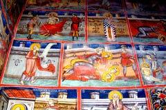 Painted walls in Moldovita Monastery, Moldavia, Romania Royalty Free Stock Photography
