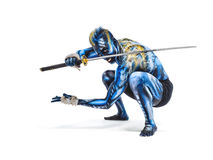 Painted Warrior BB147955. This is an image of a young martial artist bodypainted to look like a demon warrior Stock Photography
