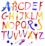 Painted watercolor alphabet. Stock Photos