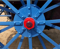 Painted wheel hub of old tractor Royalty Free Stock Photo