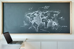 Painted white chalk map of the world in a humorous stock photos