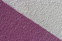 Painted white and pink plaster close-up, texture, background royalty free stock photo