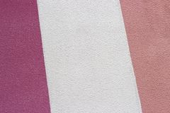 Painted white and pink plaster close-up, texture, background royalty free stock image