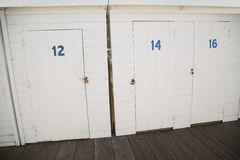 Painted white wood storage doors at boat dock Royalty Free Stock Photos