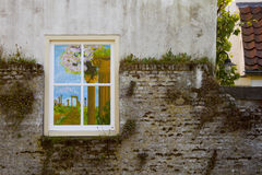 Painted window. On stone wall with moss Stock Images