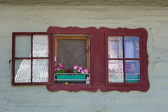 Painted window of traditional wooden house, Liptov, Slovakia stock images