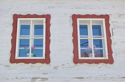 Painted windows of traditional wooden house, Liptov, Slovakia Stock Images