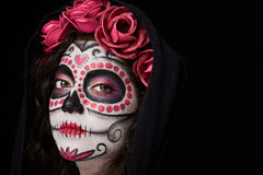 Painted woman face in cloak. Close up of painted woman face in cloak  black Royalty Free Stock Images
