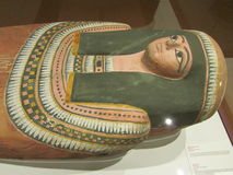 Painted wood-coffin of Nesperennub. The lid of the coffin bears an image of the deceased wearing a wig,a floral head band and a large collar. 800 BC Royalty Free Stock Photos