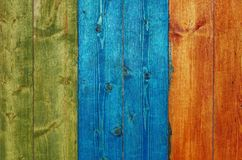 Painted wooden planks. A fragment of painted wooden planks. Red, green, blue Stock Photos