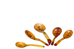Painted wood spoon handmade. Some painted spoons isolated on white background Royalty Free Stock Photos