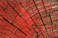 Painted wooden block texture - red. Part of a wooden pallet, this block showcases weathered wood textures and unorthodox coloring royalty free stock photography