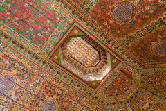A painted wooden ceiling of the Bahia Palace in Marrakesh Stock Images