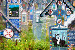 Painted wooden crosses in the famous Merry Cemetery in Maramures Stock Photos