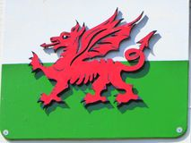 Painted wooden cut out Welsh flag. The painted wooden cut out winged dragon of the Welsh national flag in red, white and green Royalty Free Stock Images