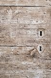 Painted wooden door with keyhole,texture. A beautiful texture painted door in the south of France with keyhole and door Knob Stock Images