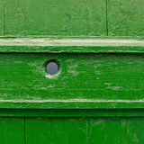 Painted wooden fence fragment. Painted green wooden fence fragment as a background texture Royalty Free Stock Photo