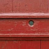 Painted wooden fence fragment. Painted red wooden fence fragment as a background texture Royalty Free Stock Photo
