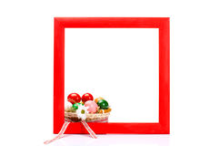Painted wooden frame with basket of easter eggs Stock Images
