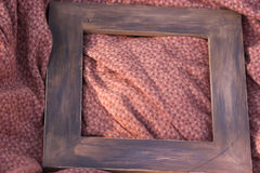 Painted wooden frame on the matter Royalty Free Stock Images