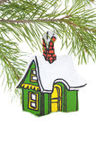 Painted Wooden House Ornament. Hand painted wooden house christmas tree ornament Royalty Free Stock Image