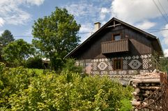 Painted Wooden House with wooden fence. The view on traditional painted houses in Cicmany village - Slovak Republic Royalty Free Stock Image