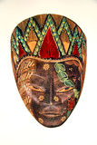 Painted wooden mask. Elaborately painted wooden mask with leaves, flowers, and designs.  African Royalty Free Stock Image